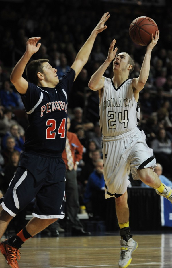 Houlton's Nicholas Guiod shoots over Penquis's Colton Larrabee during Class C action on Friday at the Cross Insurance Center.