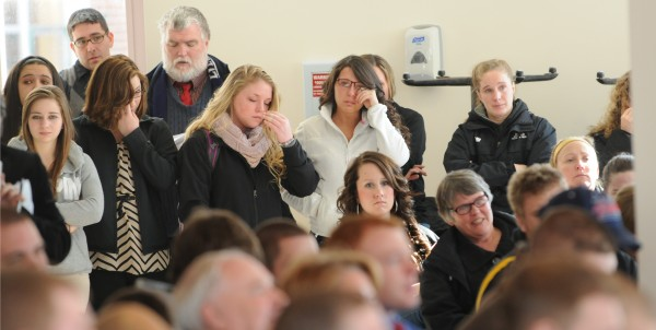 A packed room fought back tears at the G. Pierce Webber Campus Center at Husson University on Friday during a service of remembrance for football player Stephen Colvin. Colvin was killed in a skiing accident at Sugarloaf on Tuesday.