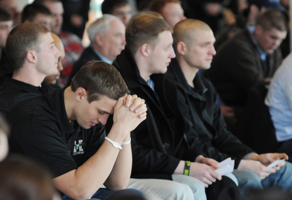 Husson football tight end Caleb King reflects during a service of remembrance for Stephen Colvin on Friday at Husson. Colvin was killed in a skiing accident at Sugarloaf on Tuesday.