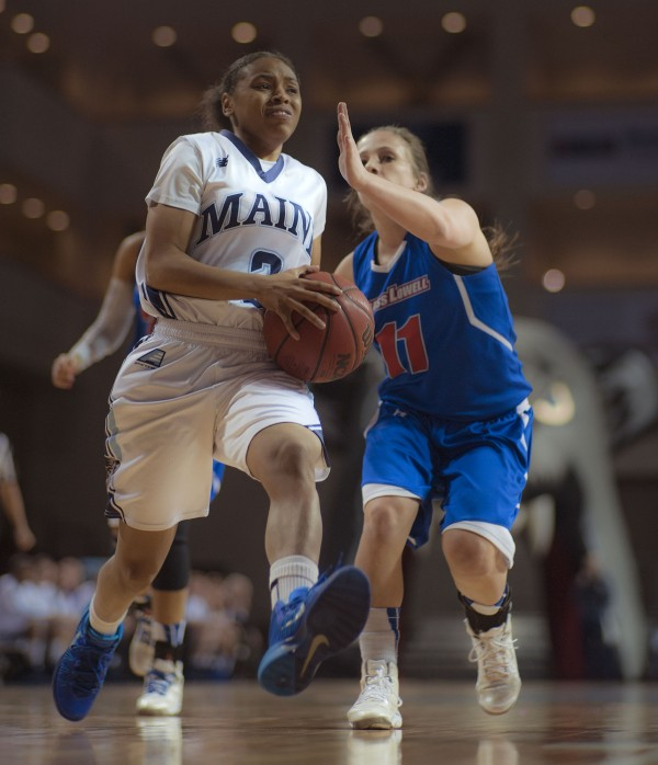 Maine's Cherrish Wallace (left) drives past UMass Lowell's Brittany Lomanno (right) in the first half of their game at the Cross Insurance Center in Bangor on Wednesday night. Maine won 84-65.