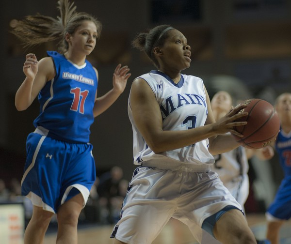 Maine's Chantel Charles (right) drives to the basket past UMass Lowell's Brittany Lomanno (left) in the first half of their game at the Cross Insurance Center in Bangor on Wednesday night. Maine won 84-65.