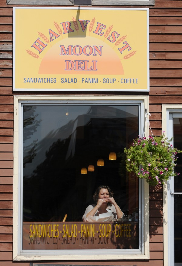 University of Maine student Brittany West eats her lunch in the window seat at Harvest Moon Deli on Mill Street in Orono on Wednesday, August 31, 2011.
