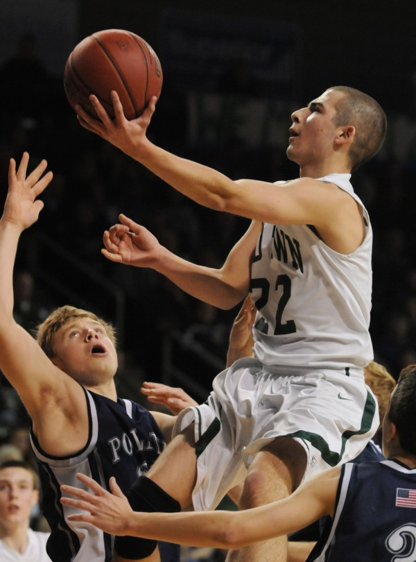 Old Town's Eric Hoogterp shoots over Poland's John Fossett during the Class B state championship game on Friday night at the Cross Insurance Center in Bangor. Old Town won 64-39.