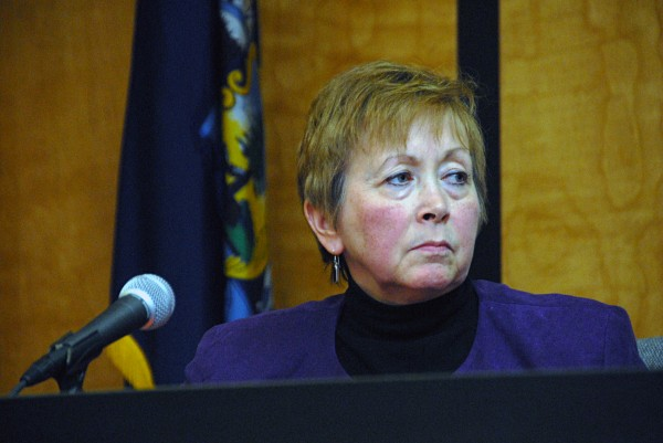 Millinocket Town Manager Peggy Daigle listens to a councilor during a Town Council meeting on Thursday, Feb. 27, 2014.