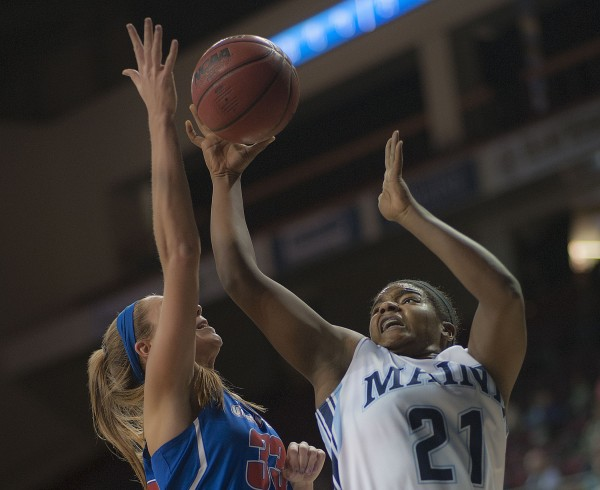 UMaine basketball player Sheraton Jones (right) gets a block from UMass Lowell player Lindsey Doucette in the first half of their game at the Cross Insurance Center in Bangor on Wednesday.