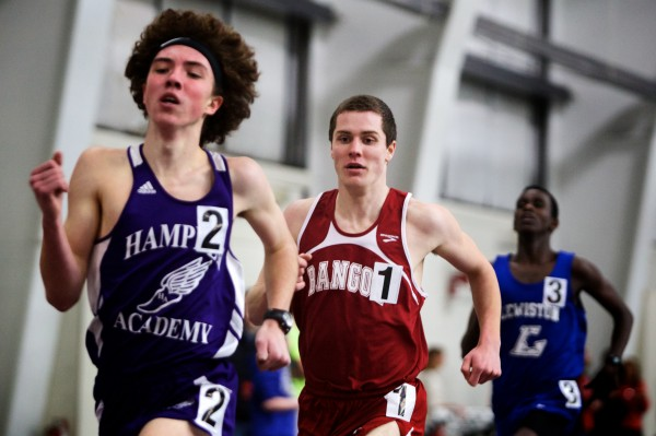 Bangor High School senior Jon Stanhope (center) runs in the mile race at the Maine Class A Indoor Track Championships at the University of Southern Maine in Gorham on Monday. Stanhope won the race.