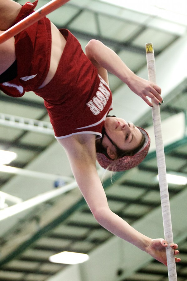 Bangor High School junior Abby Reynolds clears the bar during the pole vault competition at the Maine Class A Indoor Track Championships at the University of Southern Maine in Gorham on Monday. Reynolds won the state title in the event.