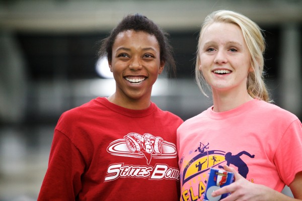 Tiffany Gray of Bangor High School (left) and Synclaire Tasker of Brewer High School smile after placing first and second in the triple jump at the Maine Class A Indoor Track Championships at the University of Southern Maine in Gorham on Monday.