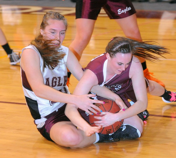 George Stevens Academy's Katrina Limeburner (left) and Washington Academy's Taylor Cushing wrestle for the ball during an East Class C prelim in Blue Hill on Tuesday evening.