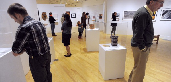 People view the pieces on display during the opening of the Twisted Path exhibition at the Abbe Museum in Bar Harbor Thursday.