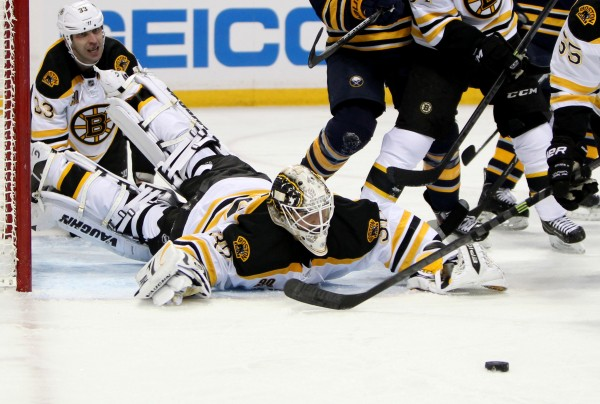 Boston Bruins goalie Chad Johnson (30) dives to clear the puck during the second period against the Buffalo Sabres at First Niagara Center Wednesday night.