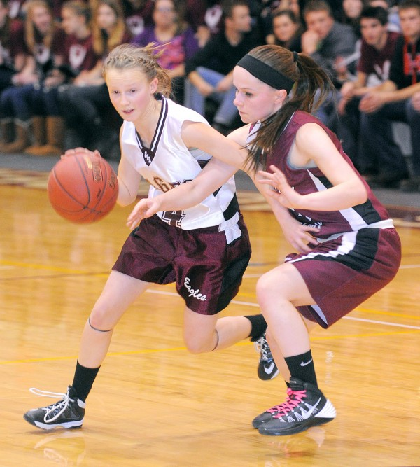George Stevens Academy's Hanna Gutow (left) drives past Washington Academy's Whitney Porter during the game in Blue Hill on Tuesday evening.