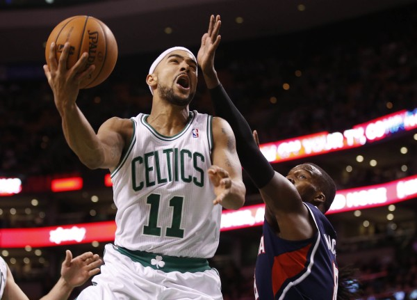 Boston Celtics point guard Jerryd Bayless (11) puts up a shot past Atlanta Hawks point guard Shelvin Mack (8) in the second half at TD Garden. The Celtics defeated the Hawks 115-104 Wednesday night.