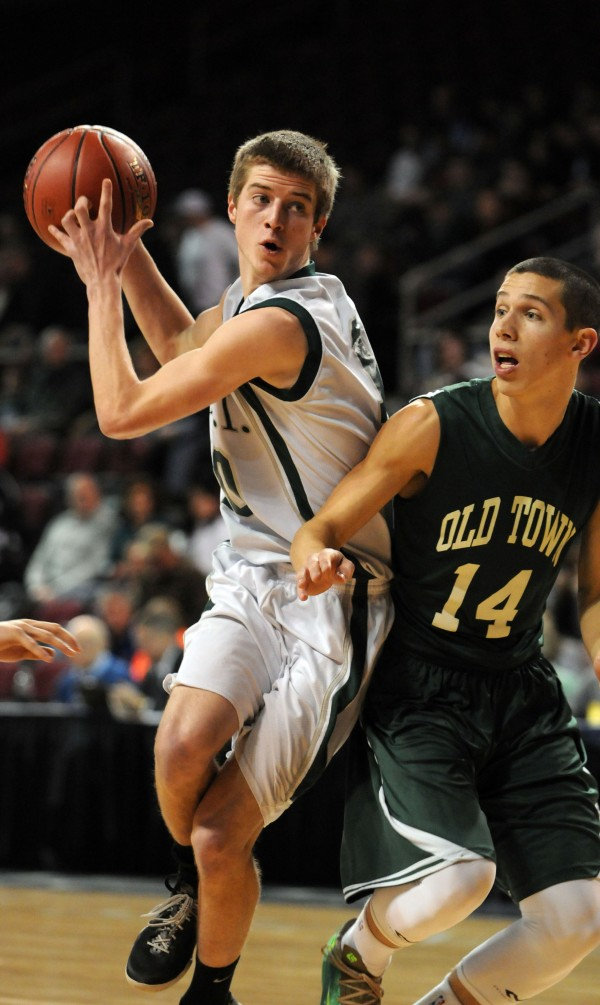 MDI's Stephen Hanscome looks to pass while being guarded by Old Town's Garvey Melmed on Friday night.