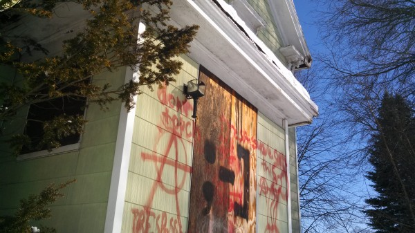 Graffiti has been painted on the boarded-up windows of an abandoned apartment building at 147 Court St. in Bangor. City officials are recommending that the city take over the building, which has several years of unpaid taxes.