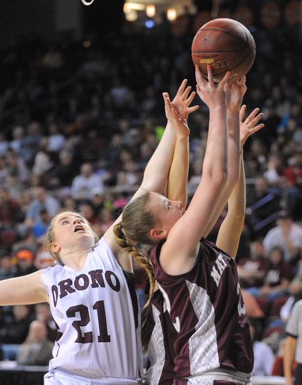Mattanawcook Academy's Sydney Robertson (right) grabs a rebound in front of Orono High School's Ally Gonyar during a Class C semifinal game at the Cross Insurance Center in Bangor Friday evening.