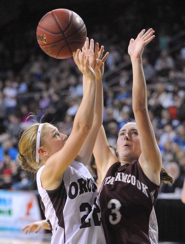 Mattanawcook Academy's Camryn Lyons (right) tries to block a shot by Orono High School's Hannah Clement during a Class C girls semifinal game at the Cross Insurance Center in Bangor Friday evening.