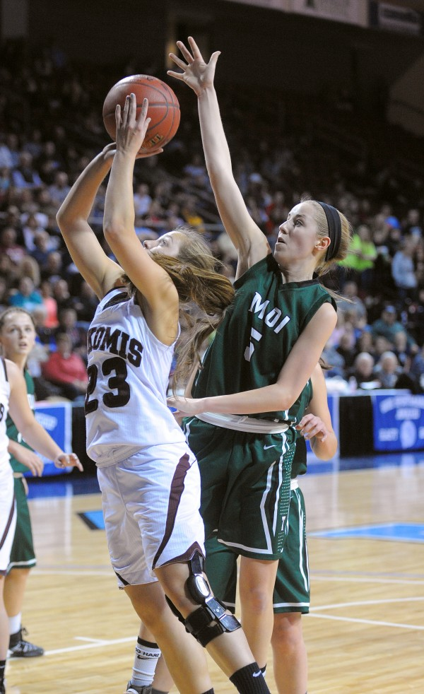 Mount Desert Island High School's Sarah Phelps (right) tries to block a shot by Nokomis High School's Kelsie Richards during a Class B girls semifinal game at the Cross Insurance Center in Bangor on Wednesday evening.