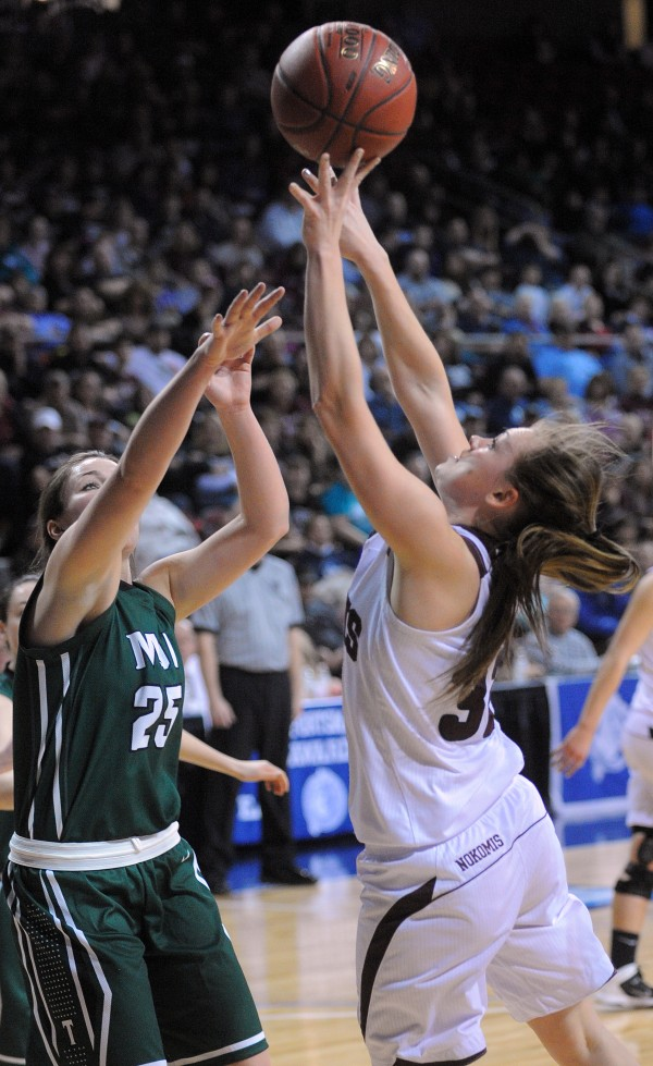 Nokomis High School's Taylor Shaw (right) goes up for a shot over Mount Desert Island High School's Hannah Shaw during a Class B girls semifinal game at the Cross Insurance Center in Bangor on Wednesday evening.