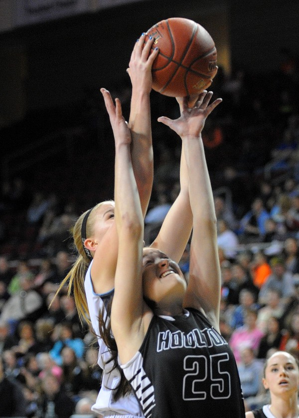 Houlton High School's Brianna Longstaff (right) and Calais High School's Katie Cavanaugh go up for a rebound during a Class C semifinal game at the Cross Insurance Center in Bangor Friday evening.