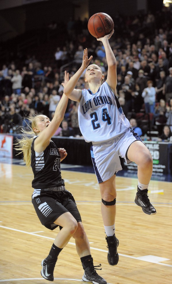 Calais High School's Katie Cavanaugh (right) goes up for a shot over Houlton High School's Samantha Keegan during a Class C semifinal game at the Cross Insurance Center in Bangor Friday evening.
