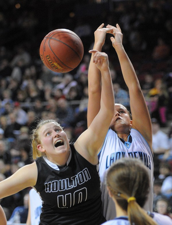 Houlton High School's Catie Condon (left) and Calais High School's Paige Gillespie scramble for a rebound during a Class C semifinal game at the Cross Insurance Center in Bangor Friday evening.