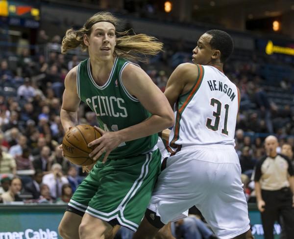 Boston Celtics center Kelly Olynyk (41) looks to shoot around Milwaukee Bucks center John Henson (31) during the second quarter at the BMO Harris Bradley Center in Milwaukee Monday night.