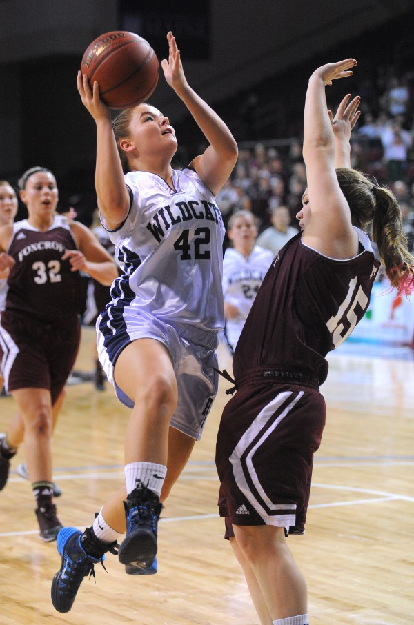 Presque Isle High School's Krystal Kingsbury goes up for a shot over Foxcroft Academy's Mackenzie Coiley during the Class B girls semifinal game at the Cross Insurance Center in Bangor on Wednesday evening.