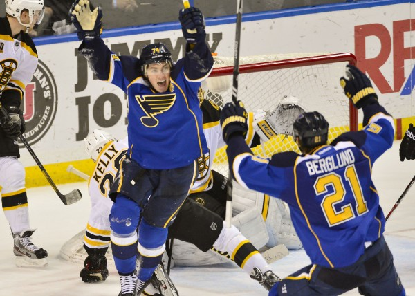 St. Louis Blues right wing T.J. Oshie (74) celebrates scoring the game-winning goal against the Boston Bruins in overtime at Scottrade Center in St. Louis Thursday night. The Blues won 3-2.