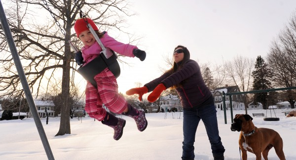 Three-year-old Vivian Anaya of Bangor gets a push from Skyla Holderman, a family friend, while playing at Fairmont Park in Bangor on Thursday afternoon. Temperatures in the region reached the mid-40s.