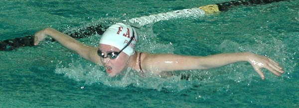 Foxcroft Academy's Gabie Johnson competes in the 100 butterfly during the Class B girls state swim meet at Bowdoin College in Brunswick Monday.