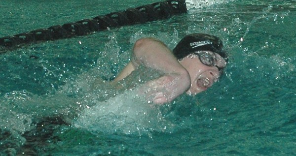 Old Town's Keegan Feero competes in the 200 freestyle during the Class B state swim meet Tuesday at Bowdoin College in Brunswick.