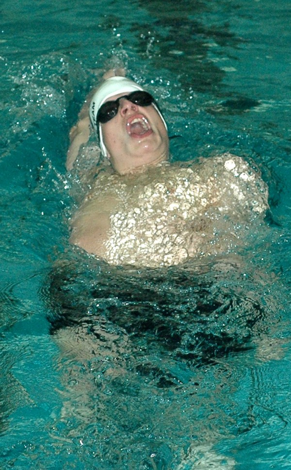 James VanKirk of John Bapst Memorial High School competes in the 100 backstroke at the Class B state swim meet Tuesday at Bowdoin College in Brunswick.
