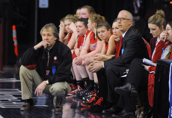 Fort Fairfield coaches and players watch the Class D girls semifinal game against Van Buren at the Cross Insurance Center in Bangor on Thursday evening.