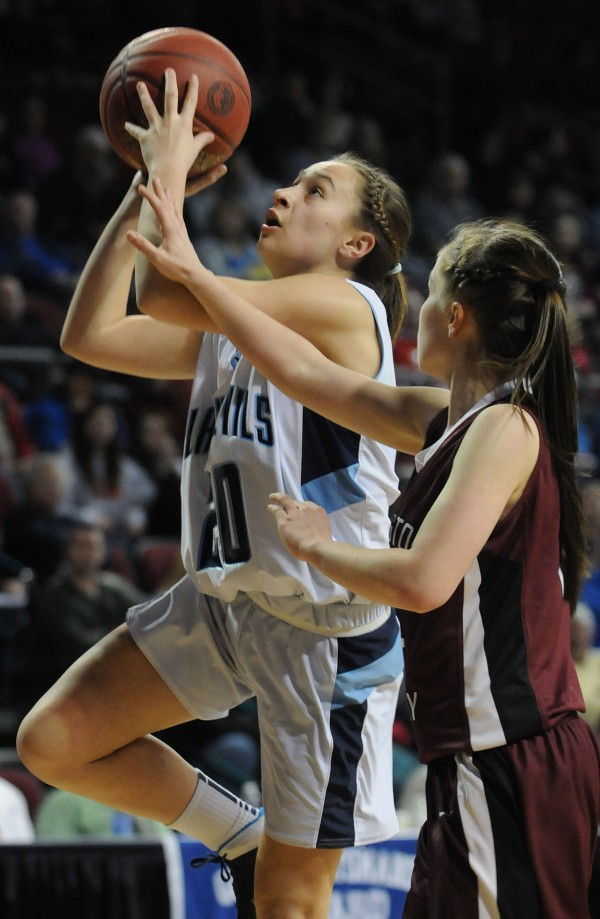 Calais's Kaylee Johnson (left) shoots while being defended by Washington Academy's Whitney Porter on Tuesday at the Cross Insurance Center during Class C action.