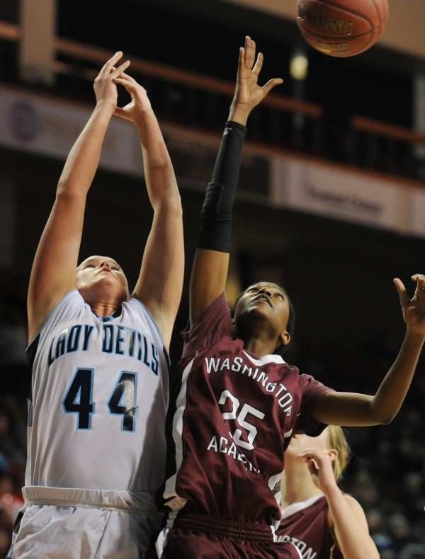 Calais's Paige Gillespie (left) and Washington Academy's Tamara Kabuye fight for a rebound on Tuesday at the Cross Insurance Center during Class C action.
