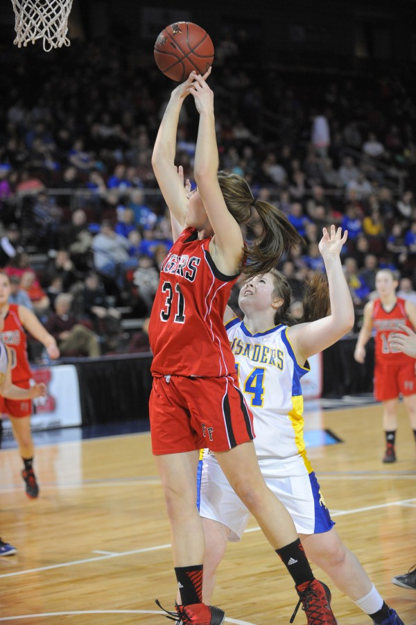 Fort Fairfield's Teresa Maynard (left) goes up for a shot over Van Buren's Emily Dumond during the Class D girls semifinal game at the Cross Insurance Center in Bangor on Thursday evening.