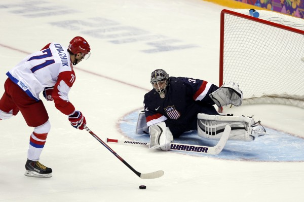 USA goalie Jonathan Quick (32) makes a save against Russia forward Ilya Kovalchuk (71) in the overtime shootout in a men's preliminary round ice hockey game during the Sochi 2014 Olympic Winter Games at Bolshoy Ice Dome.