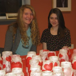 10th Grade Trekkers Chloe Finger and Sadie Bartlett making table decorations for the Trekkers' Valentine's Dance fundraiser being held at the Samoset on February 14th.