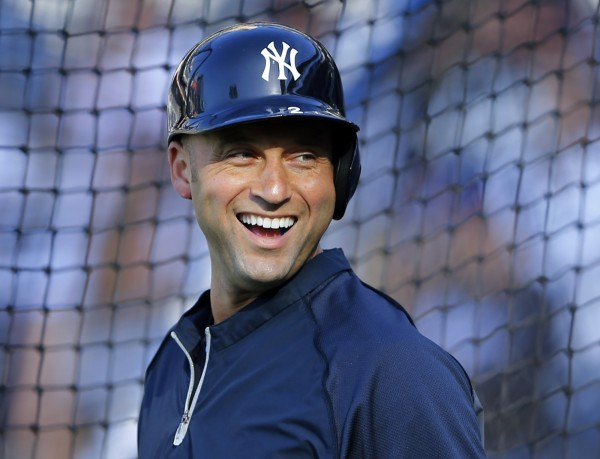 New York Yankees shortstop Derek Jeter shares a laugh during batting practice before their Major League Baseball game against the San Diego Padres in San Diego, California in this file photo taken August 2, 2013.