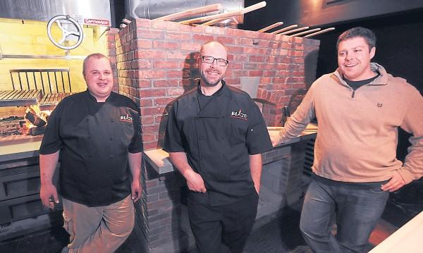 bdn photos by kevin bennett Sous chef Duncan Gunn(left) , executive chef Josh Heikkeinen, and owner Matt Haskell share a laugh as they prepare to open Blaze, Bangor's newest restaurant, on Jan. 14.