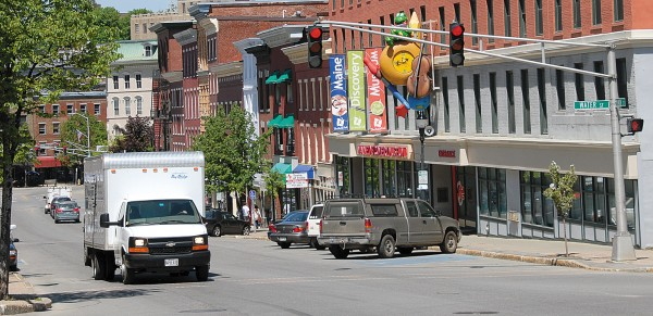 "A truck heads south along Main Street in downtown Bangor. For lovers of all things Queen City-related, nothing is more irritating that hearing a national TV newscaster or anyone else call the city ""Bang-ger,"" which rhymes with ""hang-ar."""