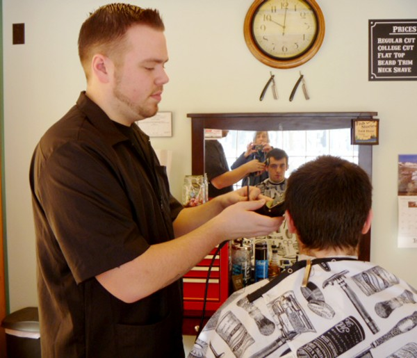Barber Zach Martin gives Tyler Norris of Hampden a buzz cut at Martin's new barbershop in Hampden.