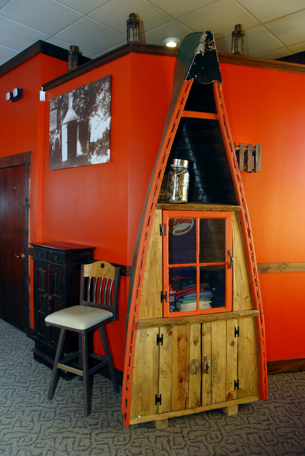 Inside the lobby of the BoomHouse Restaurant on Main Street is half a canoe into which Tom Gasaway placed a cabinet that serves as the eatery's gift shop.