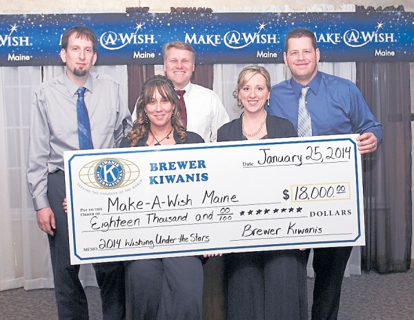 Members of the Brewer Kiwanis display the check representing the money the organization raised at its Under The Stars Gala in January. Holding the check are (from left) Kurtis Mash), Lordina Sullivan, Kim Long, Angelica Laurenovics, and Karl Laurenovics.