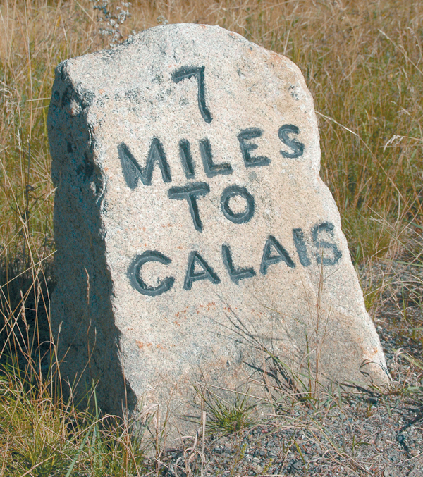 "Alongside Route 1 in eastern Washington County, a stone marker informs motorists that they must travel 7 miles to reach Calais. This Down East city, like so many Maine place names, separates with its pronunciation the natives from the people ""from away."" The ancient French seaport on the English Channel is called ""Cal-lay""; the former port at head of tide on the St. Croix River in Maine is called ""Cal-lus."""