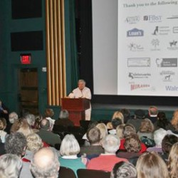 """""""Dogtripping"""" author David Rosenfelt speaks to a packed house at Rockland's Strand Theatre at PMHSKC's Feb. 6 fundraiser event"""