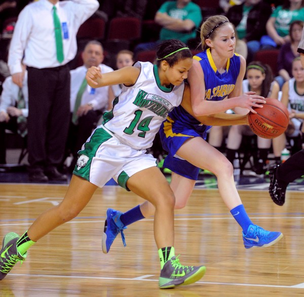 Schenck High School's Olivia Lewis (left) and Washburn High School's Mackenzie Worcester scramble for the ball during a Class D girls semifinal game at the Cross Insurance Center in Bangor on Thursday evening.