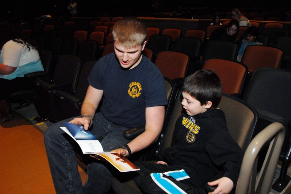 Brewer High School senior Joshua Lugdon, who lives in Dedham, reads &quotThe Adventures of Blake&quot with Blake, a Brewer Community School first-grader. After Blake wrote a letter to Brewer High students enrolled in creative writing classes taught at Michelle Macdonald and Kevin Napolillo, Lugdon transformed the letter into a story book featuring Blake as the main character.