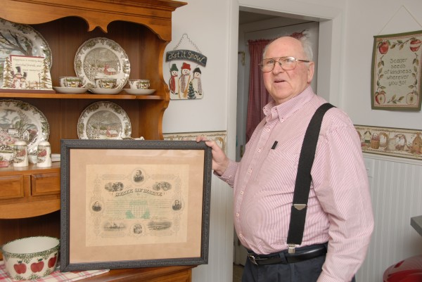 Ken Preble displays the matted and framed testimonial that Maine Gov. Joshua L. Chamberlain presented to Preble's great-grandfather, Charles Melvin Preble, on July 4, 1868. The testimonial recognized Charles Preble for his service to the Union during the Civil War; he spent almost three years with the 11th Maine Infantry Regiment. School Street Picture Framing in Brewer preserved the document for Ken Preble.